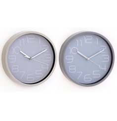 Modern wall clock, approx 20 cm diameter. Styled in shades of grey, with neon-esque numbering