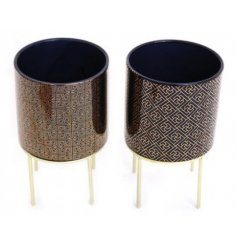 Ceramic plant pot in royal blue or purple with gold geometric embellishment and gold metal legs. Approx 25 cm high