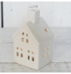 Small porcelain house-shaped tealight holder measures approx 11.3 cm tall
