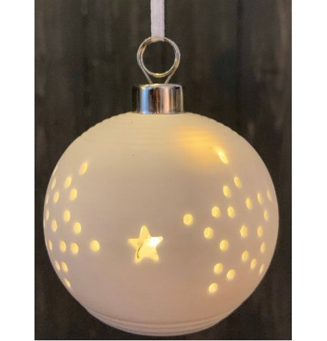 A unique white ceramic bauble with a stamped star design which reveals a stunning warm glow LED light
