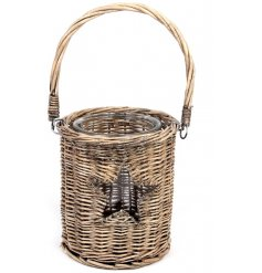 A rustic willow lantern with a woven handle and star shaped design.