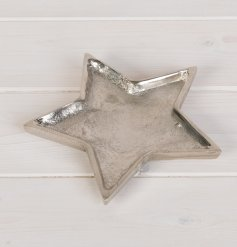 A chic silver metal star shaped dish with a hammered finish. A rough luxe interior accessory for the home.