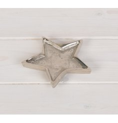 A chic, medium sized, silver star dish with a hammered finish. Ideal for storing small items.
