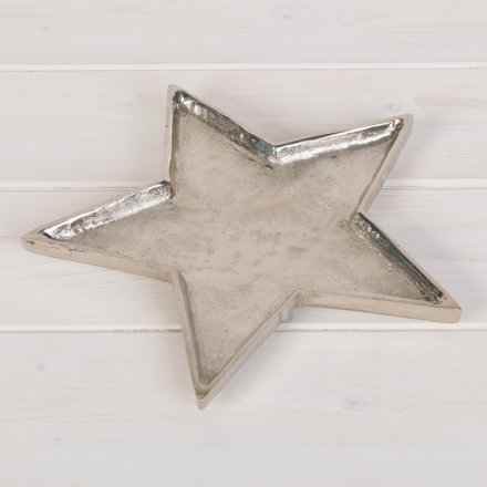 A stylish silver metal star shaped dish with a hammered finish.