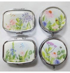 Useful metal pill boxes in 4 assorted floral & insect designs, either lozenge shaped or circular.