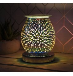 Stunning Goblet-shaped lamp with built in oil burner and starburst design. Approx  size 12 x 17 cm