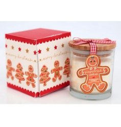 A cute gingerbread man design glass candle with a matching colour gift box.