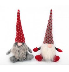 An assortment of 2 nordic gonk doorstops with long pointed pattered hats and faux fur beards.