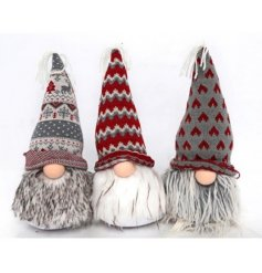 A mix of 3 fairisle gonks with beautifully patterned hats. The assortment includes grey and red designs.