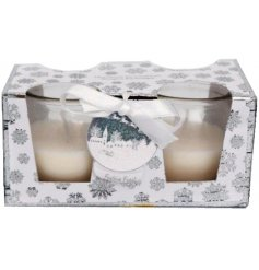 A set of 2 scented candle pots with a shimmering silver and white snowflake gift box.