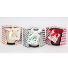 An assortment of 3 Christmas tipple candle pots in Prosecco Bellini, Gin Fizz and Festive Spice fragrances.
