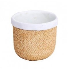 A white and natural woven style ceramic planter.
