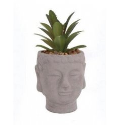 This buddha head vase with artificial succulent is a stylish interior accessory.