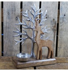 Fabulous rustic tealight holder showing wooden reindeer silhouetted against silver aluminium tree. Approx 29 x 22 x 8 cm