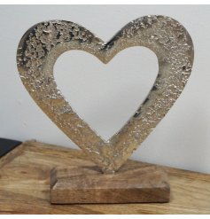 Open heart ornament crafted from textured aluminium fixed on a solid wooden base. Approx size 19.5 x 5 x 18 cm