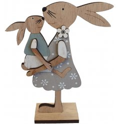 A cute wooden bunny decoration dressed up in a pretty frock