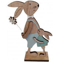 A small wooden rabbit decoration set with blue dungarees