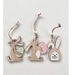 A set of 6 rustic wooden rabbit decorations in 3 assorted designs. Key features include polkadot eggs and bunny ears.