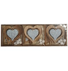A cute little set of hanging wooden hearts each decorated with a blue and white polka dot decal