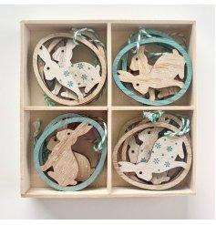 8 pack Easter wooden hanging decorations of bunny inside egg, decorated with floral print. Measures approx 6 cm tall