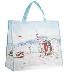 A beautifully illustrated beach/shopper bag with a charming coastal scene.