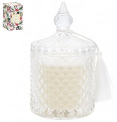 An elegant glass candle pot filled with a beautifully scented wax and placed in a Tropical themed Gift Box