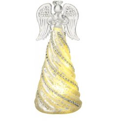 A beautiful glass angel decoration with LED lights. Complete with an ornate swirling skirt.