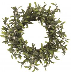A festive round wreath entwined with traditional mistletoe