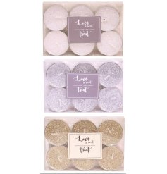 An assortment of glittery topped tlight candles, each packaged in a 'Love is Sweet' scripted box