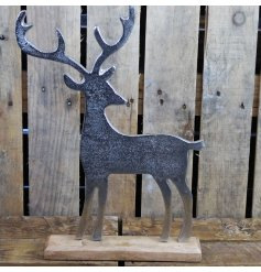 Make a statement with this chic rustic living reindeer with a hammered silver finish and chunky wooden base.