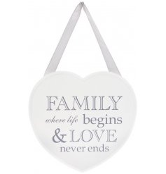 A chic wooden heart shaped plaque with a popular family and love slogan.