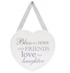 Bless this home with friends, love and laughter. A stylish heart shaped sign with a popular sentiment slogan.