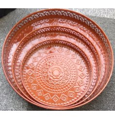 A set of assorted sized trays each set with a terracotta tone and embossed decals