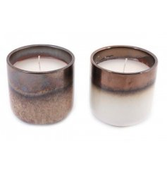 Coated with a sleek Iron glazing, this assortment of chunky candle pots will be sure to feature in any home