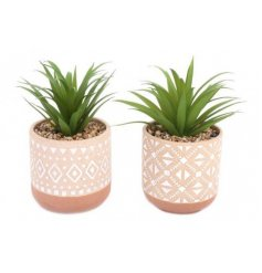 A mix of artificial succulents in ceramic patterned pots