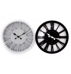 An assortment of Black and White toned Clocks with large Roman Numeral Numbers surrounding