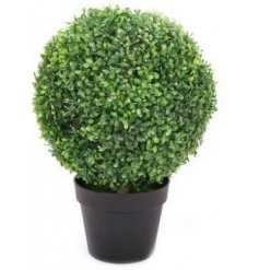 A round artificial topiary tree placed within a simple black pot