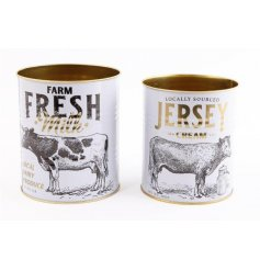 An assorted sized set of metal tins featuring a Farm Fresh decal