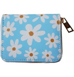 A small zip up purse with a pretty blue tone and daisy print decal