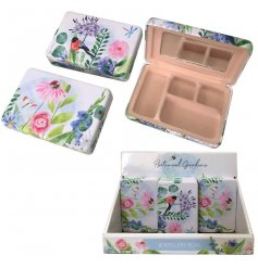 A small jewellery box with 4 little compartments and an added mirror