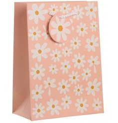 A delicate pink toned gift bag featuring a pretty Daisy decal