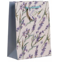 A medium sized lavender printed gift bag with a matching gift tag