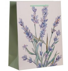 A large sized lavender printed gift bag with a pretty blue toned handle