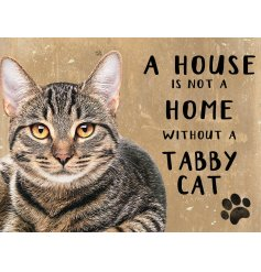 A distressed metal sign featuring a wide eyed tabby cat decal and scripted text