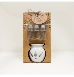 A beautifully packaged oil burner complete with deliciously scented oils, sure to bring a cosy aroma to your home