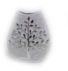 A large silver toned vase with an added Tree of Life decal on the front