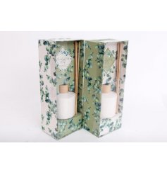 A sweetly scented reed diffuser placed within a charmingly decorated box and jute bow