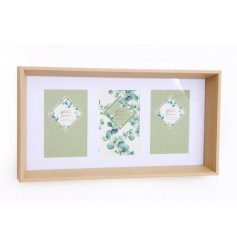 A natural wooden edged picture frame with 3 photo spaces