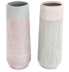 An assortment of 2 rustic stoneware vases in bold painted patterns. Each has a highly distressed finish