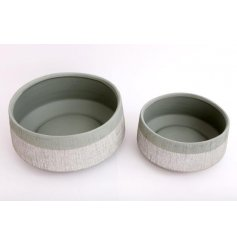 A set of 2 contemporary round planters with a distressed finish. Painted in chic sage and grey colours.